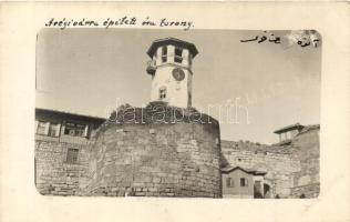 Unknown location, clock tower, castles wall