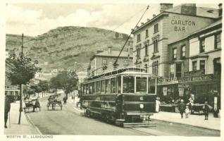 Llandudno, Mostyn street, The Carlton Bar, Briggs & Comp. Leicester Manufacturers, Stangg F. & Co., trams