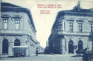 Bród, Slavonski Brod, Brod na Savi; Banska ulica / Banus Gasse / utcakép, Hanza, A. Radosavljevic üzlete. W. L. 135. / street view, shops