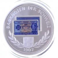 Svájc DN Banknoten der Schweiz 1907 / Billets de Banque de Suisse - Banconote della Svizzera ezüstözött Cu-Ni emlékérem 100Fr svájci bankjegy multicolor képével, tanúsítvánnyal (40mm) T:PP  Switzerland ND Banknoten der Schweiz 1907 / Billets de Banque de Suisse - Banconote della Svizzera silver plated Cu-Ni commemorative medallion with the multicolor image of 100 Francs banknote, with certificate (40mm) C:PP