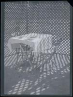 cca 1935 Kinszki Imre (1901-1945) budapesti fotóművész hagyatékából, jelzés nélküli, vintage NEGATÍV (Asztal, a térelválasztó rács árnyékában), 5.9x4,4 cm