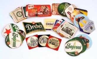 45 db különböző méretű és alakú magyar és külföldi söralátét, közötte 3 db bőr, jó állapotan