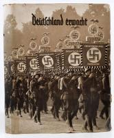 1933 Deutschland erwacht gyűjtőalbum Hitler hatalomra kerülésének történetét ábrázoló cigarettacímkékkel. Komplett, 200 címkével. Egészvászon kötésben, jó állapotban, plusz hozzá az eredeti papírborító, ami ritkaság / Collecting pictures in album about Hitlers route to power. Complete with original paper cover