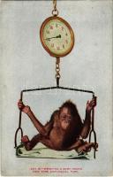 New York City, New York Zoological Park, weighing a baby orang (EK)