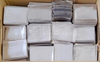 Két doboznyi műanyag fóliatok, főleg két méretben (74x61mm/86x71mm). Jó állapotban