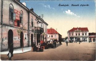 Érsekújvár, Nové Zámky; Kossuth Lajos tér, Nemzeti Szálloda, Pollak üzlete, piaci árusok. Vasúti Levelezőlapárusítás 245. / square, hotel, shops, market vendors