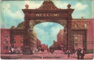 1909 Denver (Colorado), welcome arch, horse-drawn carriages, tram (wet damage)