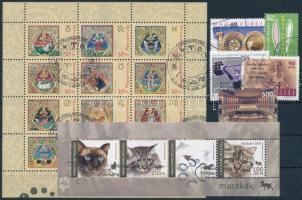 2004 59 klf. bélyeg, közte teljes sorok + 1 blokk +1 kisív 3 db stecklapon (16.670)