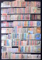 Kb. 1.900 db különféle bélyeg, közte jugoszláv, sok színű angol- és francia gyarmati kiadások (Hongkong, Danzig, Reich, stb.) 12 lapos nagyalakú berakóban